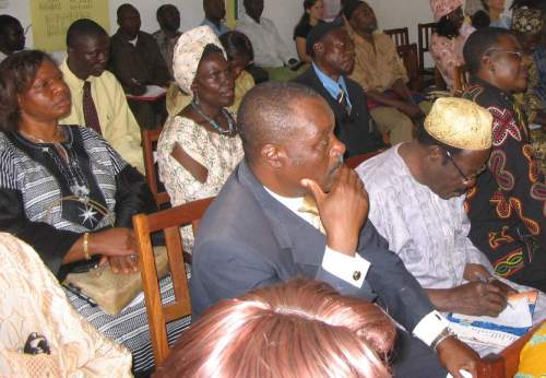 Audience listening to Bible reading in local languages