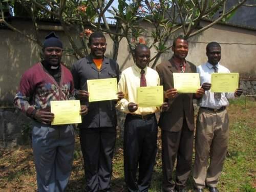 Ezekiel, Edward, Novetan, David and Pius with their course certificates