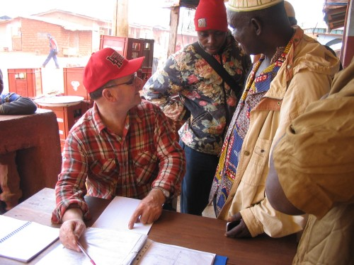 Mick discussing the water situation with Bafanji elders, Ndop, NW Cameroon