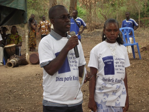 Tra Didier speaking at the dedication of the Kouya New Testament in March 2012