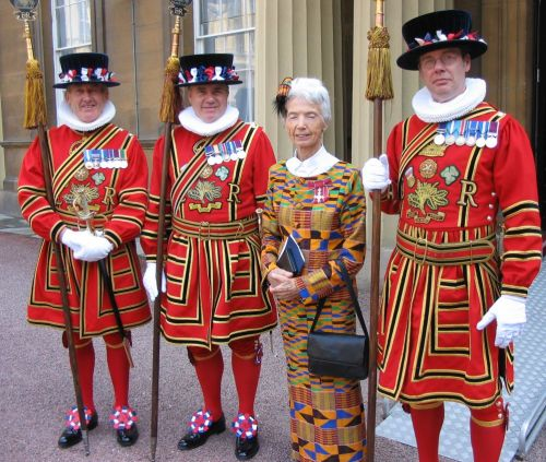 Mary Steele MBE at Buckingham Palace with some colourful friends