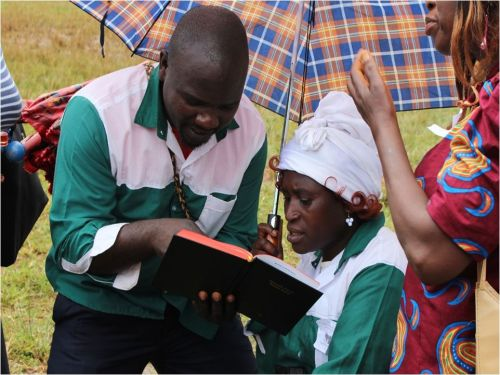 An Oku couple study the New Testament as soon as they received it