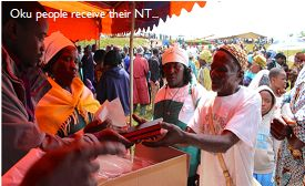Oku people receiving their New Testaments