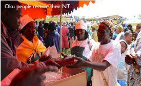 Oku people receiving their New Testaments
