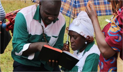 Oku couple, NW Cameroon, reading their newly published New Testament