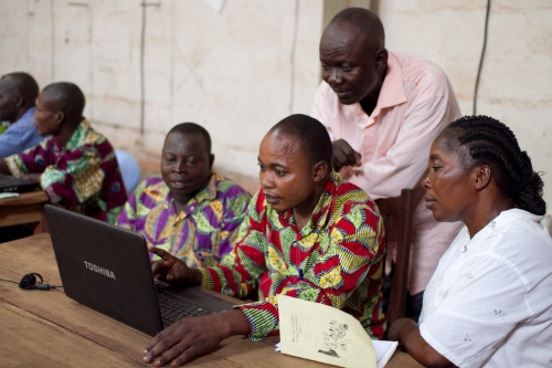 Four members of the Mono translation team at work in Gemena, DRC