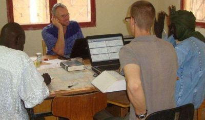 Michael, the consultant / scrum half in action with a translation team in Mali