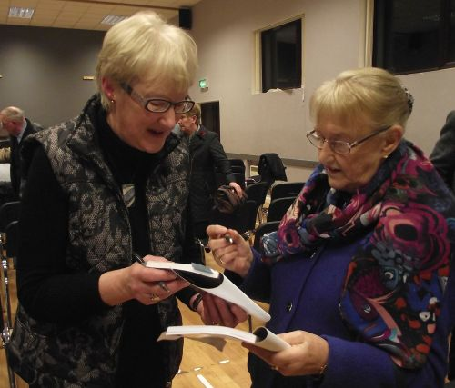May Kirkpatrick and Elizabeth McLeister sign each other's copies